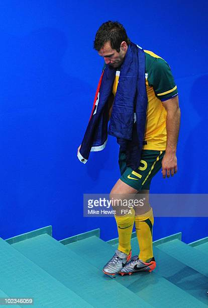 Lucas Neill of Australia walks back to the dressing room dejected after the 2010 FIFA World Cup South Africa Group D match between Australia and...