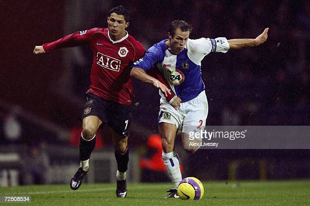 Lucas Neill of Blackburn Rovers battles for the ball with Cristiano Ronaldo of Manchester United during the Barclays Premiership match between...