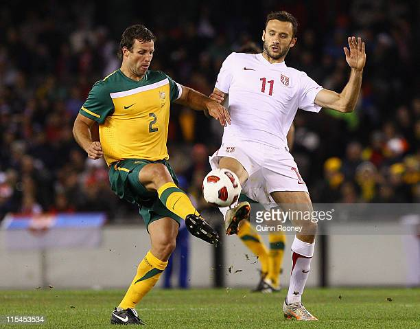 Lucas Neill of the Socceroos and Jovan Damjanovic of Serbia contest for the ball during the international friendly match between the Australian...