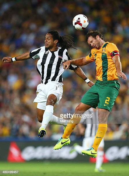 Lucas Neill of the Socceroos competes for a header with Jonathan McDonald of Costa Rica during the international friendly match between the...