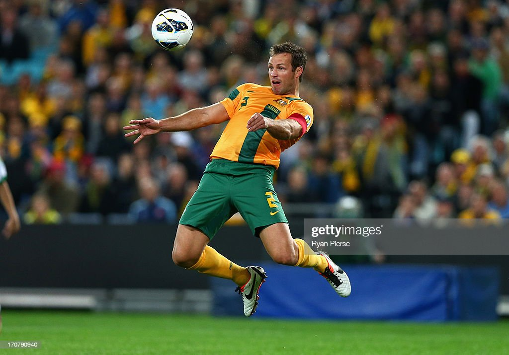 <a gi-track='captionPersonalityLinkClicked' href=/galleries/search?phrase=Lucas+Neill&family=editorial&specificpeople=213118 ng-click='$event.stopPropagation()'>Lucas Neill</a> of the Socceroos heads the ball during the FIFA 2014 World Cup Asian Qualifier match between the Australian Socceroos and Iraq at ANZ Stadium on June 18, 2013 in Sydney, Australia.