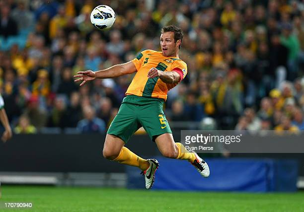 Lucas Neill of the Socceroos heads the ball during the FIFA 2014 World Cup Asian Qualifier match between the Australian Socceroos and Iraq at ANZ...