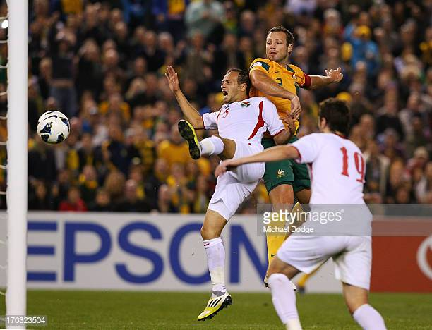 Lucas Neill of the Socceroos heads the ball for a goal during the FIFA World Cup Qualifier match between the Australian Socceroos and Jordan at...
