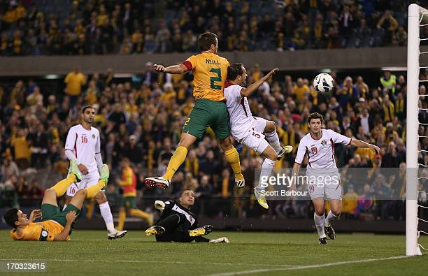 Lucas Neill of the Socceroos scores a goal during the FIFA World Cup Qualifier match between the Australian Socceroos and Jordan at Etihad Stadium on...