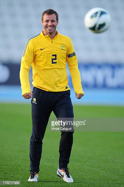 Lucas Neill of the socceroos smiles during an Australian Socceroos training session at Lakeside Stadium on June 9 2013 in Melbourne Australia