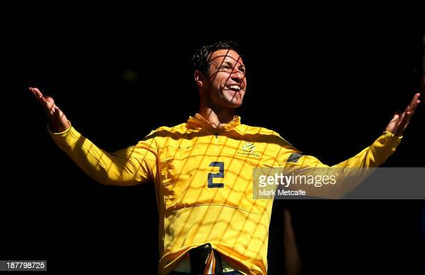 Lucas Neill reacts to the good weather as he arrives for a Socceroos Training Session at WIN Jubilee Stadium on November 13 2013 in Sydney Australia