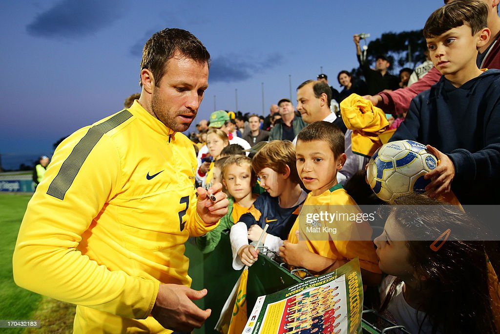 <a gi-track='captionPersonalityLinkClicked' href=/galleries/search?phrase=Lucas+Neill&family=editorial&specificpeople=213118 ng-click='$event.stopPropagation()'>Lucas Neill</a> signs autographs for fans during an Australian Socceroos training session at WIN Jubilee Stadium on June 13, 2013 in Sydney, Australia.