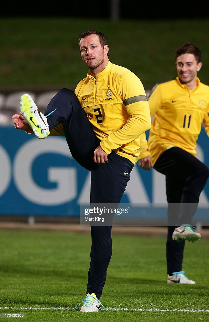 <a gi-track='captionPersonalityLinkClicked' href=/galleries/search?phrase=Lucas+Neill&family=editorial&specificpeople=213118 ng-click='$event.stopPropagation()'>Lucas Neill</a> stretches during an Australian Socceroos training session at WIN Jubilee Stadium on June 13, 2013 in Sydney, Australia.