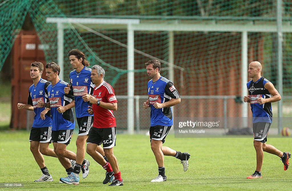 <a gi-track='captionPersonalityLinkClicked' href=/galleries/search?phrase=Lucas+Neill&family=editorial&specificpeople=213118 ng-click='$event.stopPropagation()'>Lucas Neill</a> warms up with teammates during a Sydney FC A-League training session at Macquarie Uni on February 17, 2013 in Sydney, Australia.