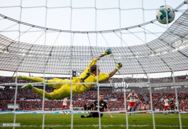 Lucas Nicolas Alario of Bayer Leverkusen scores his teams second goal against Christian Mathenia of Hamburg during the Bundesliga match between Bayer...