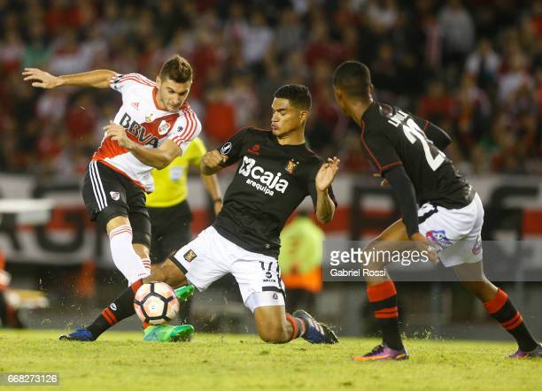 Lucas Nicolas Alario of River Plate fights for the ball with Anderson Santamaria of Melgar during a match between River Plate and FBC Melgar as part...