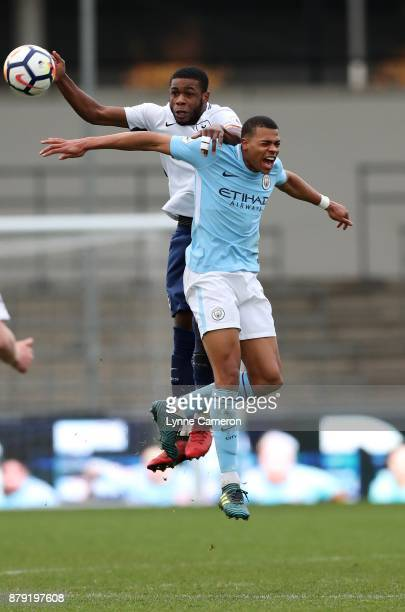Lucas Nmecha of Manchester City and Japer Zananga of Tottenham Hotspur during the Premier League 2 at The Academy Stadium on November 25 2017 in...