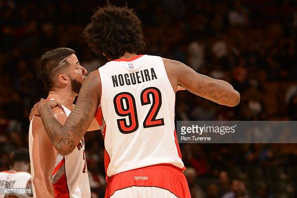Lucas Nogueira and Greivis Vasquez of the Toronto Raptors talk during the game against Maccabi Haifa on October 22 2014 at the Air Canada Centre in...