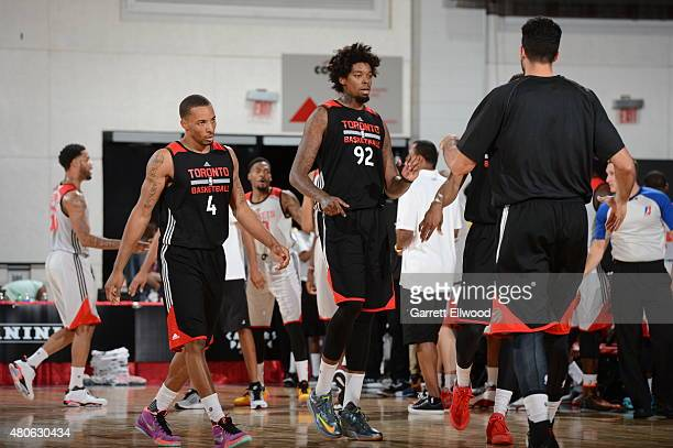 Lucas Nogueira and Norman Powell of the Toronto Raptors celebrate with their teammates during the 2015 NBA Las Vegas Summer League game against the...