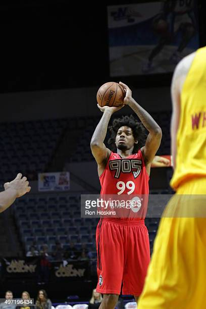 Lucas Nogueira of the Raptors 905 shoots over a Mad Ants defender during their NBDL game at Memorial Coliseum November 14 2015 in Fort Wayne Indiana...