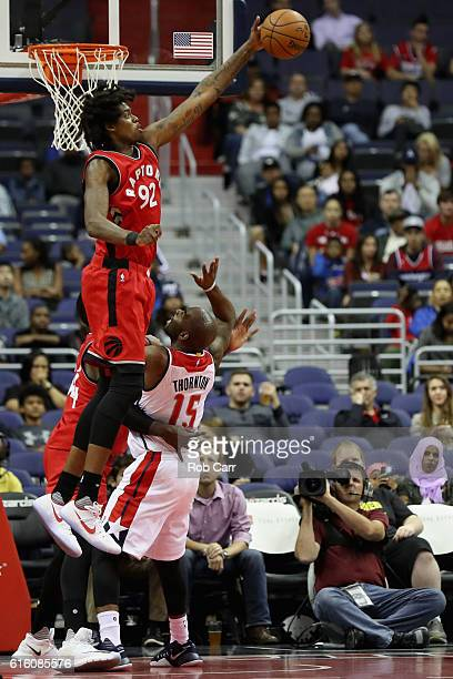 Lucas Nogueira of the Toronto Raptors blocks a shot by Marcus Thornton of the Washington Wizards in the first half at Verizon Center on October 21...