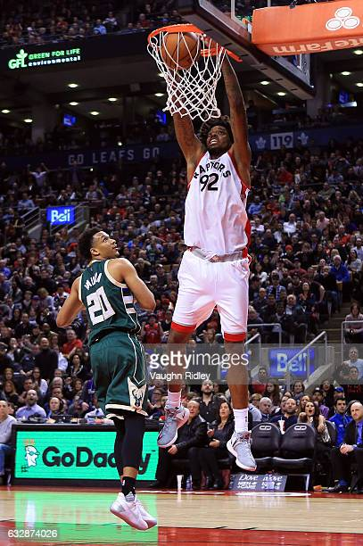 Lucas Nogueira of the Toronto Raptors dunks the ball as Rashad Vaughn of the Milwaukee Bucks defends during the second half of an NBA game at Air...