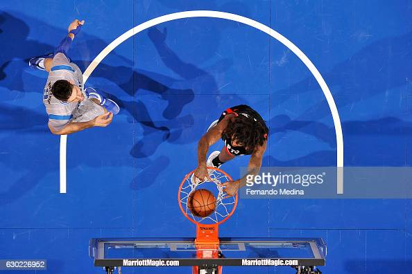 Lucas Nogueira of the Toronto Raptors dunks the ball during the game against the Orlando Magic on December 18 2016 at Amway Center in Orlando Florida...