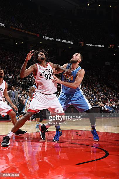 Lucas Nogueira of the Toronto Raptors fights for the position against Joffrey Lauvergne of the Denver Nuggets on December 3 2015 at the Air Canada...