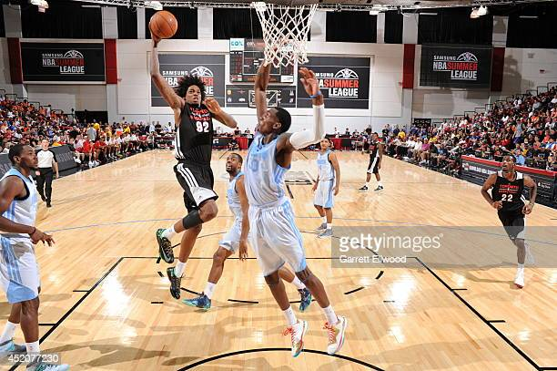 Lucas Nogueira of the Toronto Raptors goes up for a dunk against the Denver Nuggets at the Samsung NBA Summer League 2014 on July 12 2014 at the Cox...