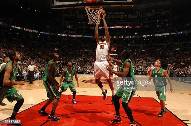 Lucas Nogueira of the Toronto Raptors goes up for shot against Maccabi Haifaon October 22 2014 at the Air Canada Centre in Toronto Ontario Canada...