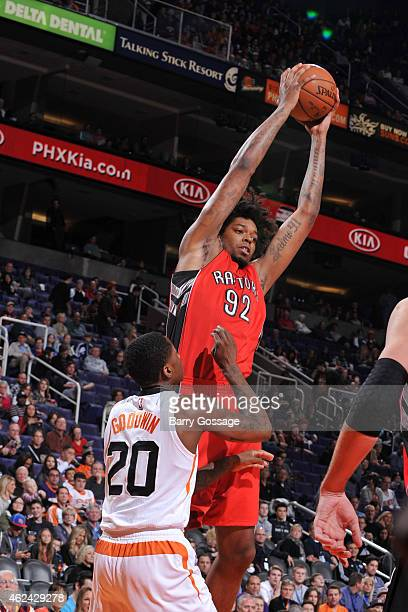 Lucas Nogueira of the Toronto Raptors grabs a rebound against the Phoenix Suns on January 4 2015 at US Airways Center in Phoenix Arizona NOTE TO USER...