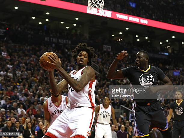 Lucas Nogueira of the Toronto Raptors grabs the rebound against the Golden State Warriors on December 5 2015 at Air Canada Centre in Toronto Ontario...