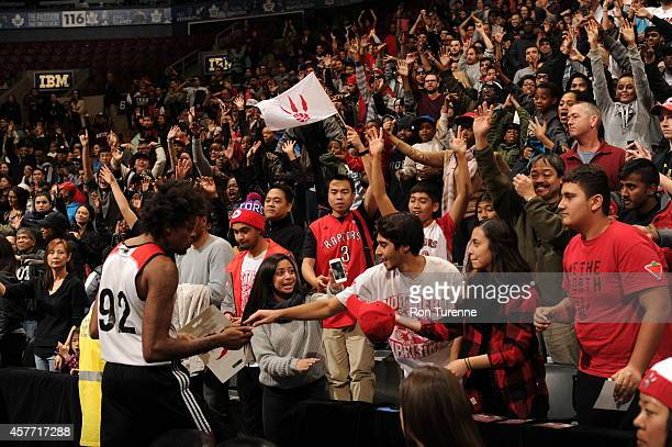 Lucas Nogueira of the Toronto Raptors greets fans during practice on October 19 2014 at the Air Canada Centre in Toronto Ontario Canada NOTE TO USER...
