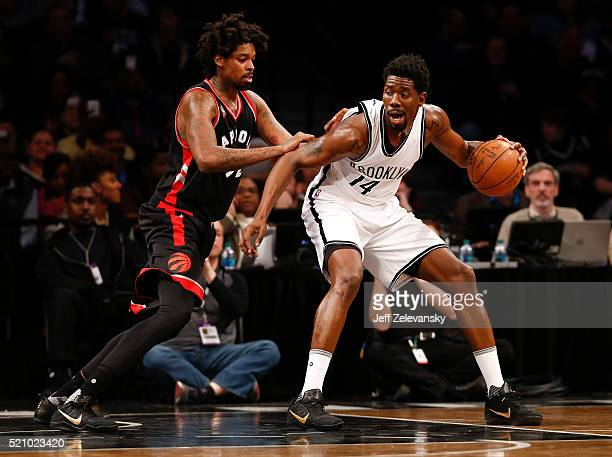 Lucas Nogueira of the Toronto Raptors guards Henry Sims of the Brooklyn Nets during their game at the Barclays Center on April 13 2016 in New York...
