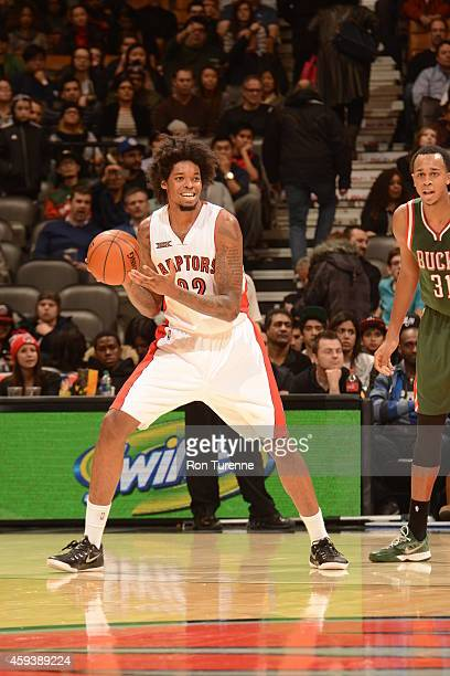 Lucas Nogueira of the Toronto Raptors handles the ball against the Milwaukee Bucks during the game on November 21 2014 at the Air Canada Centre in...
