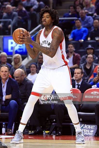 Lucas Nogueira of the Toronto Raptors passes the ball during the first half of an NBA game against the Brooklyn Nets at Air Canada Centre on January...