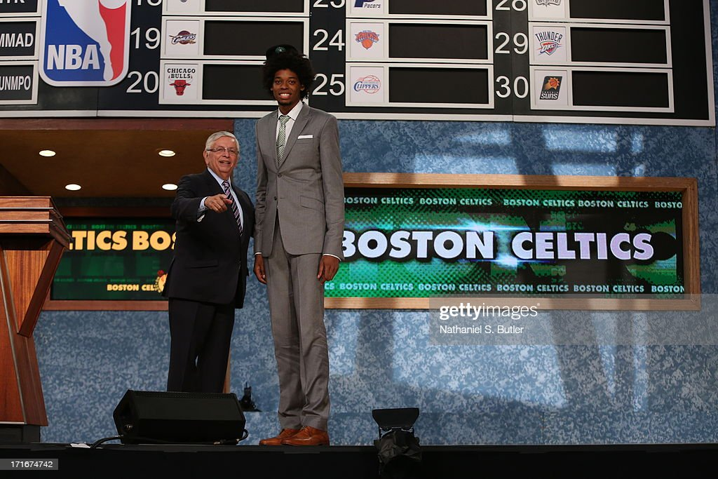 Lucas Nogueira shakes hands with NBA Commissioner, David Stern after being selected number sixteenth overall by the Boston Celtics during the 2013 NBA Draft on June 27, 2013 at Barclays Center in Brooklyn, New York.