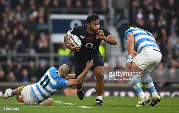 Lucas Noguera of Argentina and Santiago Cordero of Argentina attempt to stop Billy Vunipola of England during the Old Mutual Wealth Series match...