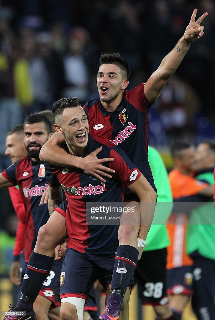Lucas Ocampos (down) and Giovanni Simeone of Genoa CFC (up) celebrate a victory at the end of the Serie A match between Genoa CFC and Juventus FC at Stadio Luigi Ferraris on November 27, 2016 in Genoa, Italy.