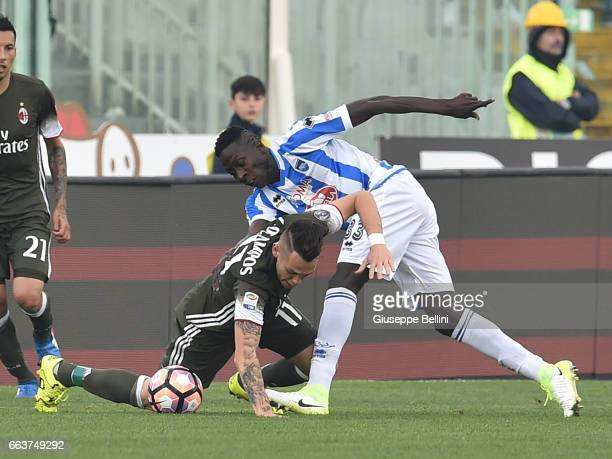 Lucas Ocampos of AC Milan and Mamadou Coulibaly of Pescara Calcio in action during the Serie A match between Pescara Calcio and AC Milan at Adriatico...