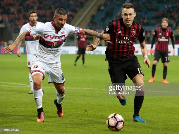 Lucas Ocampos of AC Milan competes for the ball with Armando Izzo of Genoa CFC during the Serie A match between AC Milan and Genoa CFC at Stadio...