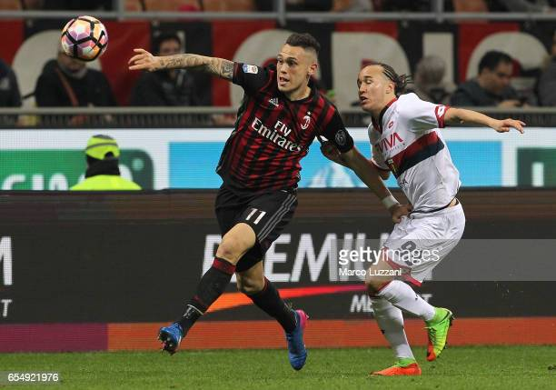 Lucas Ocampos of AC Milan competes for the ball with Diego Laxalt of Genoa CFC during the Serie A match between AC Milan and Genoa CFC at Stadio...