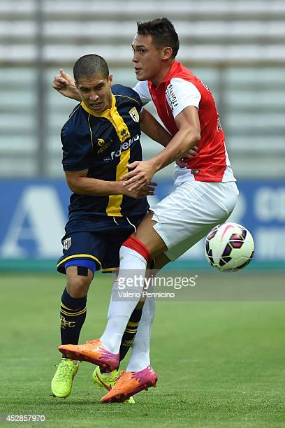 Lucas Ocampos of AS Monaco FC clashes with Jose Mauri of FC Parma during the preseason friendly match between FC Parma and AS Monaco FC at Stadio...