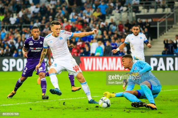 Lucas Ocampos of Marseille and Alban Lafont of Toulouse during the Ligue 1 match between Olympique Marseille and Toulouse at Stade Velodrome on...