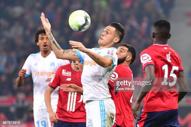 Lucas Ocampos of Marseille and Fares Bahlouli of Lille during the Ligue 1 match between Lille OSC and Olympique Marseille at Stade Pierre Mauroy on...