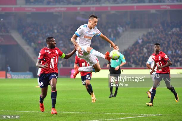 Lucas Ocampos of Marseille and Ibrahim Amadou of Lille during the Ligue 1 match between Lille OSC and Olympique Marseille at Stade Pierre Mauroy on...