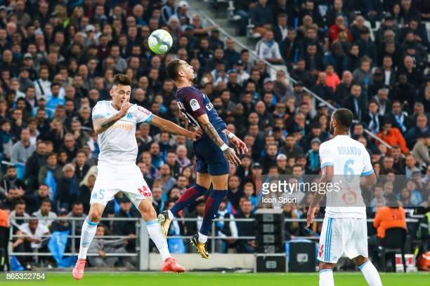 Lucas Ocampos of Marseille and Layvin Kurzawa of Paris during the Ligue 1 match between Olympique Marseille and Paris Saint Germain at Stade...