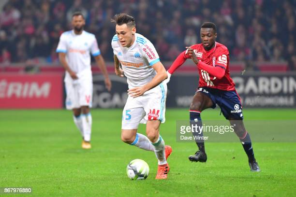 Lucas Ocampos of Marseille and Nicolas Pepe of Lille during the Ligue 1 match between Lille OSC and Olympique Marseille at Stade Pierre Mauroy on...