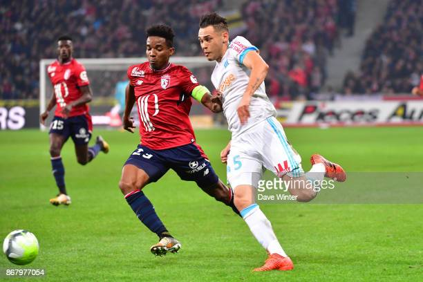 Lucas Ocampos of Marseille and Thiago Mendes of Lille during the Ligue 1 match between Lille OSC and Olympique Marseille at Stade Pierre Mauroy on...