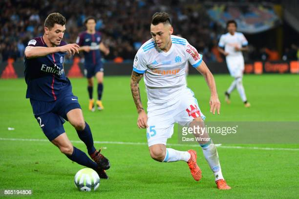 Lucas Ocampos of Marseille and Thomas Meunier of PSG during the Ligue 1 match between Olympique Marseille and Paris Saint Germain at Stade Velodrome...