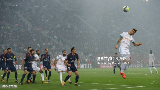 Lucas Ocampos of Marseille heads the ball away from a corner during the Ligue 1 match between Olympique Marseille and Paris Saint Germain at Stade...