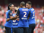 Lucas Ocampos of Monaco celebrates scoring to make it 22 with Falcao and Fabonho during the Emirates Cup match between Valencia and AS Monaco at the...