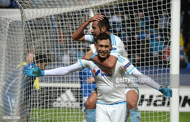 Lucas Ocampos of Olympique de Marseille celebrates with Mauricio Isla after scoring during the UEFA Europa League football match between FC Slovan...