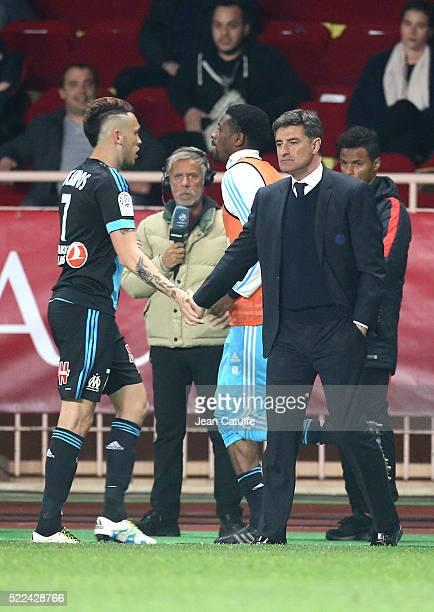 Lucas Ocampos of Olympique de Marseille greets Coach of Olympique de Marseille Jose Miguel Gonzalez Martin del Campo aka Michel while Abou Diaby of...