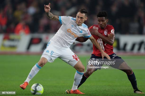 Lucas Ocampos of Olympique Marseille Thiago Mendes of Lille during the French League 1 match between Lille v Olympique Marseille at the Stade Pierre...